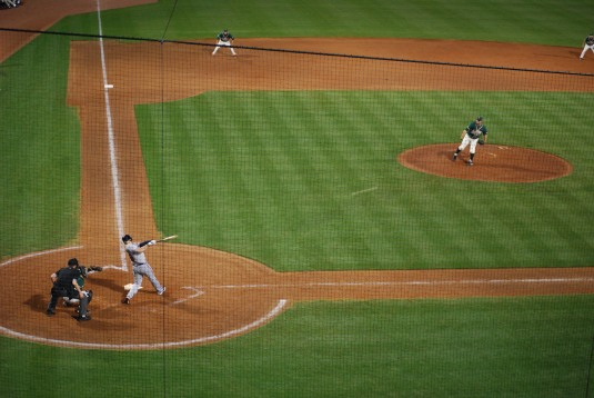Brian McCann hits an RBI double to tie the game in the 9th. Photo Credit: Patrick Abbott