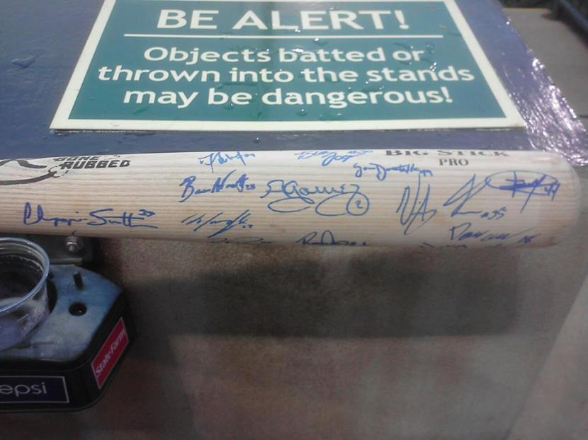 Bat autographed by the 2013 Greensboro Grasshoppers team.